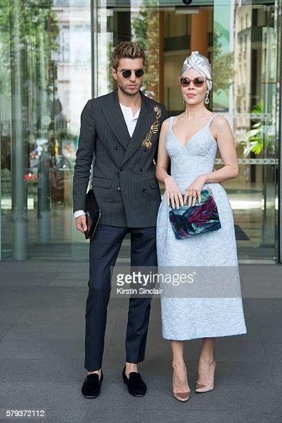 Marketing director Frol Burimskiy with Fashion designer Ulyana Sergeenko wearing an Ulyana Sergeenko dress and bag and Christian Louboutin shoes day...