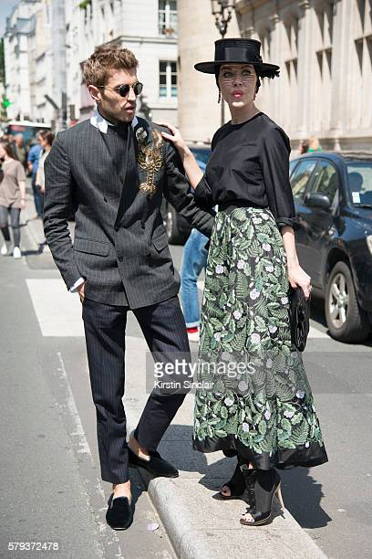 Marketing director Frol Burimskiy with Fashion designer Ulyana Sergeenko wearing an Ulyana Sergeenko blouse and skirt Steven Jones hat and Guiseppe...