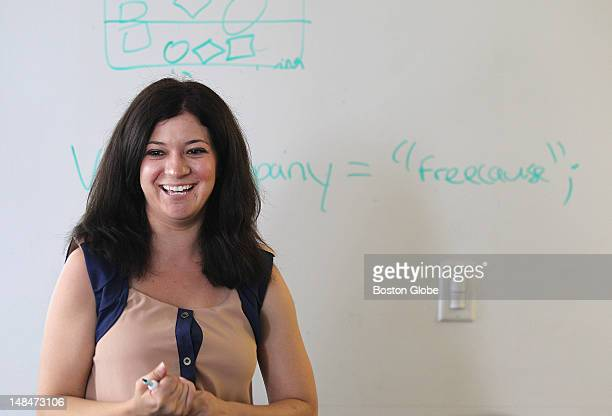 Marketing manager Elizabeth Goncalves beams after successfully declaring a string variable on the board Technical and nontechnical employees of...