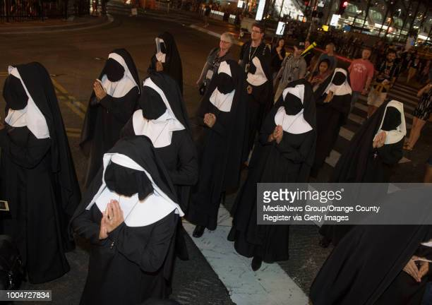 A marketing mob wanders the streets promoting the horror movie 'The Nun' during Comic Con 2018 in San Diego on Thursday July 19 2018