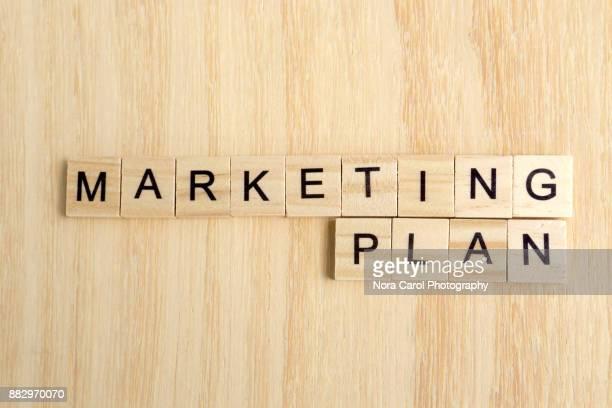 Marketing Plan on Word on Wooden Tile Block