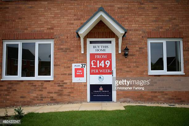 Marketing signs adorn the front of new homes on a housing development on May 20, 2014 in Middlewich, England. Official figures have shown that house...