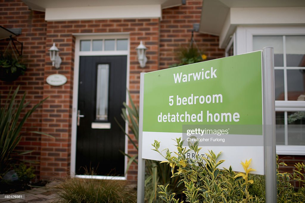 Marketing signs adorn the front of new homes on a housing development on May 20, 2014 in Middlewich, England. Official figures have shown that house prices have risen by 8% in the year ending in March. There have been calls by some experts for the UK Help to Buy scheme to be scaled down as it boosts the property market.