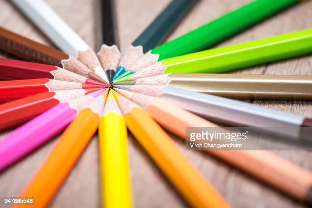 marketing target, crayon group lay in a circle - sports target stock photos and pictures