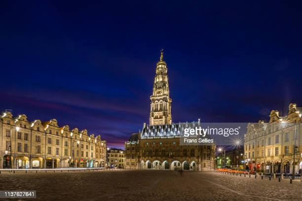 marketplace in arras with the illuminated belfry, france - アラス ストックフォトと画像