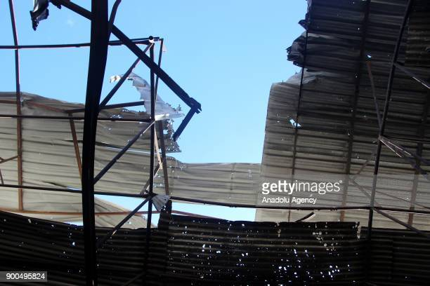 A market's rooftop is seen damaged after a missile attack carried out by Assad Regime Forces hit the deescalation zone of Jisr AlShughur in Idlib...