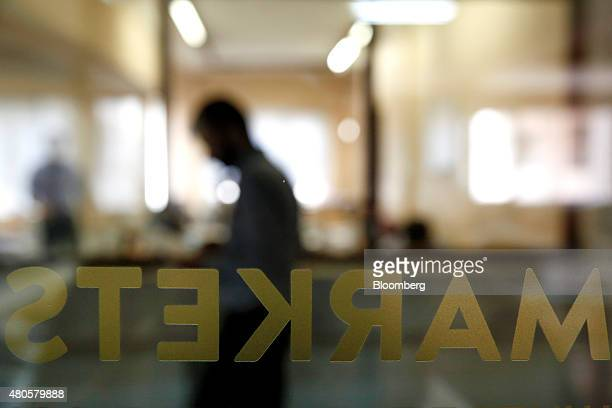 A 'Markets' sign sits on the trading floor inside the offices of Nuntius Securities SA brokers in Athens Greece on Monday July 13 2015 Greece has...