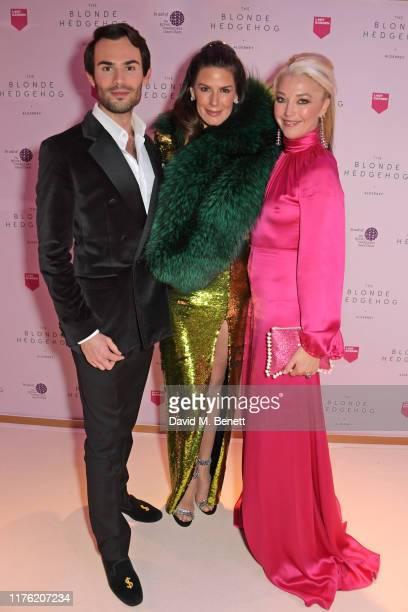 MarkFrancis Vandelli Christina Estrada and Tamara Beckwith attend the Lady Garden Foundation Gala 2019 at Claridge's Hotel on October 16 2019 in...