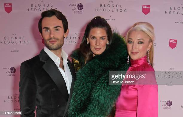 MarkFrancis Vandelli Christina Estrada and Tamara Beckwith attend the Lady Garden Foundation Gala 2019 at Claridge's Hotel on October 16 2019 in...