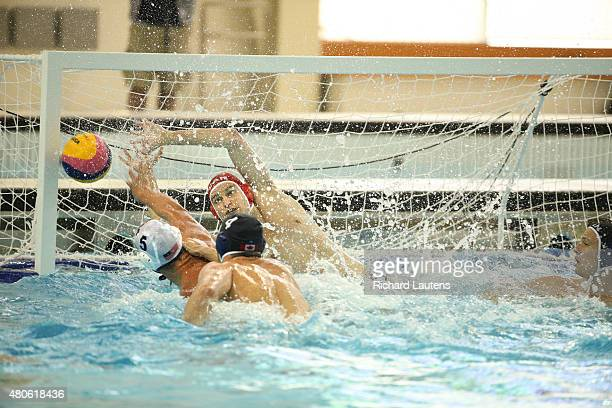 Markham Canada July 13 2015 Canadian goalie Robin Randall tries to stop the shot from American Alex Roelse with Canadian Nicolas Bicari working some...