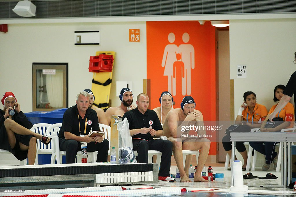 Markham, Canada - July, 13 2015 - The Canadian bench looks glum late in the 4th quarter. Canada lost to the USA in the Pan Am men's Water Polo semi-final 9-8 that was held at the Atos Markham Centre Monday night with the winner moving on to the gold medal match. Toronto2015 July 13, 2015