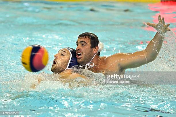 Markham Canada July 7 Canadian Nicolas Bicari gets manhandled by Brazil's Josip Virlic Canadian Men lost to Brazil 119 in Water Polo at the Atos...