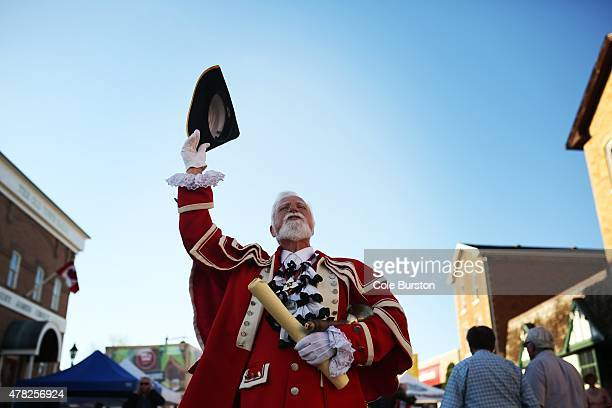 Markham's town crier John Webster delivers a cry at the Markham Village Music Festival