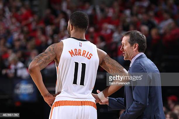 Markieff Morris and Jeff Hornacek of the Phoenix Suns speak during a game against the Portland Trail Blazers on February 5 2015 at the Moda Center...