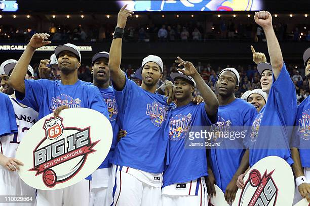Markieff Morris and Josh Selby of the Kansas Jayhawks of the Kansas Jayhawks celebrate with their teammates after defeating the Texas Longhorns 8573...