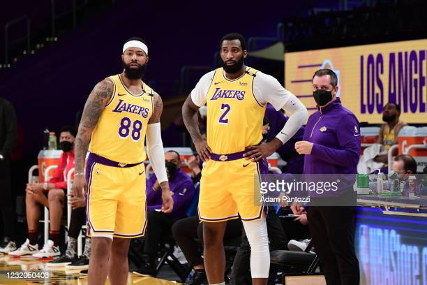 Markieff Morris, Andre Drummond and Head Coach Frank Vogel of the Los Angeles Lakers stand on the sidelines during the game against the Milwaukee...