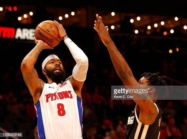 Markieff Morris of the Detroit Pistons attacks the basket against Treveon Graham of the Atlanta Hawks in the first half at State Farm Arena on...