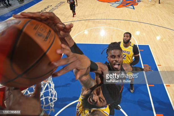 Markieff Morris of the Los Angeles Lakers dunks the ball around Nerlens Noel of the New York Knicks on April 12, 2021 at Madison Square Garden in New...