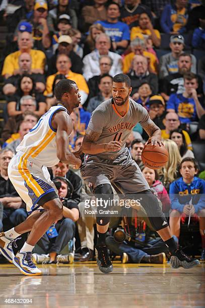 Markieff Morris of the Phoenix Suns handles the ball against the Golden State Warriors on April 2 2015 at Oracle Arena in Oakland California NOTE TO...