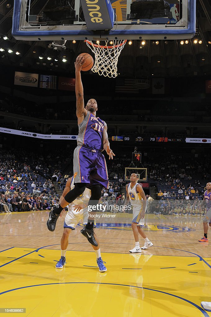 Markieff Morris #11 of the Phoenix Suns lays the ball up against the Golden State Warriors during a pre-season game on October 23, 2012 at Oracle Arena in Oakland, California.