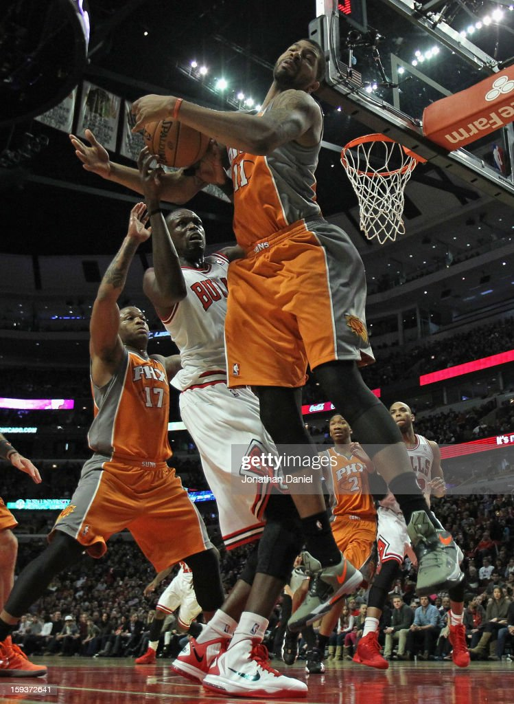 Markieff Morris #11 of the Phoenix Suns slams Loul Deng #9 of the Chicago Bulls at the United Center on January 12, 2013 in Chicago, Illinois. The Suns defeated the Bulls 97-81.