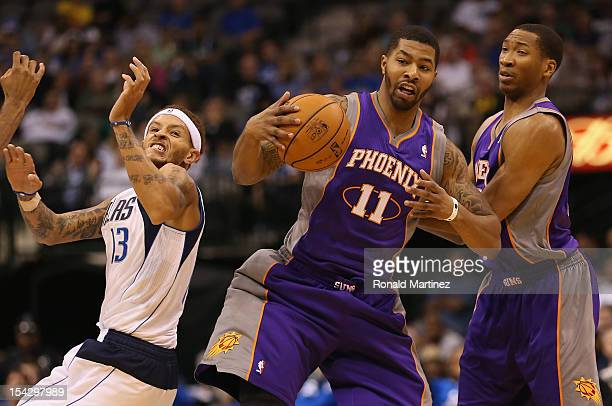 Markieff Morris of the Phoenix Suns steals the ball in front of Delonte West of the Dallas Mavericks and Wesley Johnson during a preseason game at...