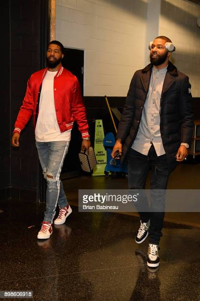 Markieff Morris of the Washington Wizards and Marcus Morris of the Boston Celtics arrives before game on December 25 2017 at the TD Garden in Boston...