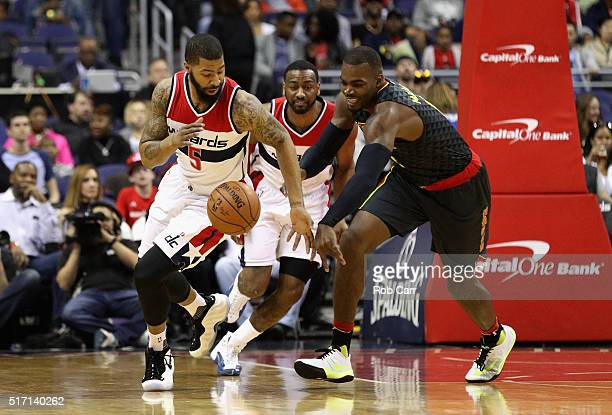Markieff Morris of the Washington Wizards and Paul Millsap of the Atlanta Hawks go after a loose ball in the first half at Verizon Center on March 23...