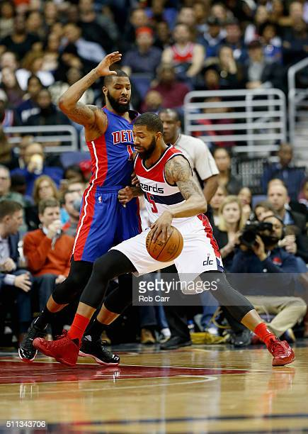 Markieff Morris of the Washington Wizards drives to the basket against his twin brother Marcus Morris of the Detroit Pistons in the first half at...