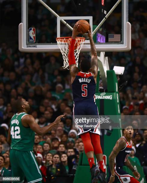 Markieff Morris of the Washington Wizards dunks during the fourth quarter of the game against the Boston Celtics at TD Garden on December 25 2017 in...