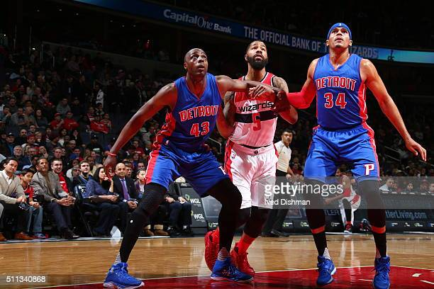 Markieff Morris of the Washington Wizards fights for position against Anthony Tolliver of the Detroit Pistons and Tobias Harris of the Detroit...
