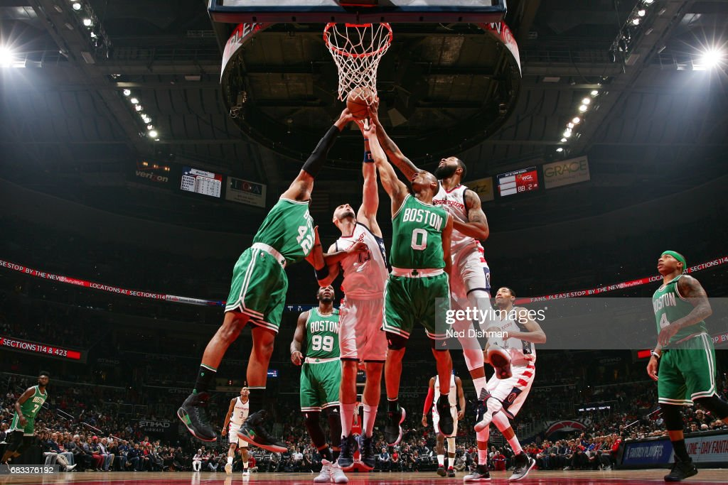 Markieff Morris #5 of the Washington Wizards fights for the rebound against Avery Bradley #0 of the Boston Celtics and dance team performs during Game Six of the Eastern Conference Semifinals of the 2017 NBA Playoffs on May 12, 2017 at Verizon Center in Washington, DC.