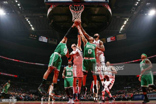 Markieff Morris of the Washington Wizards fights for the rebound against Avery Bradley of the Boston Celtics and dance team performs during Game Six...