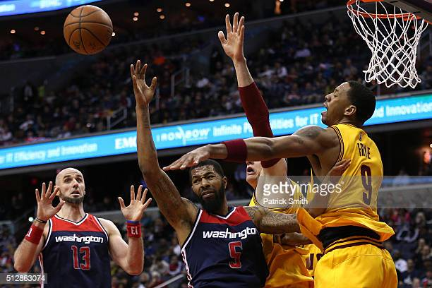 Markieff Morris of the Washington Wizards has a shot blocked by Channing Frye of the Cleveland Cavaliers during the second half at Verizon Center on...