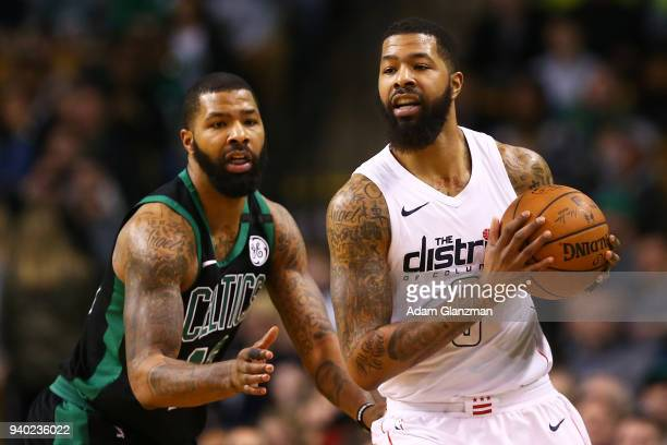 Markieff Morris of the Washington Wizards is guarded by his brother Marcus Morris of the Boston Celtics in the fourth quarter during a game at TD...