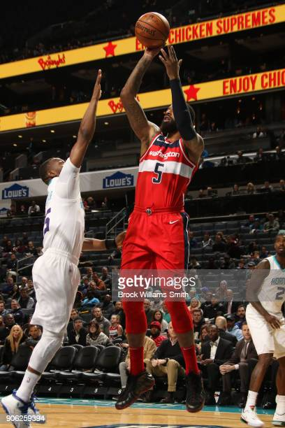 Markieff Morris of the Washington Wizards shoots the ball during the game against the Charlotte Hornets on January 17 2018 at Spectrum Center in...