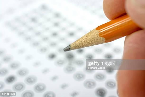 Marking an exam answer sheet
