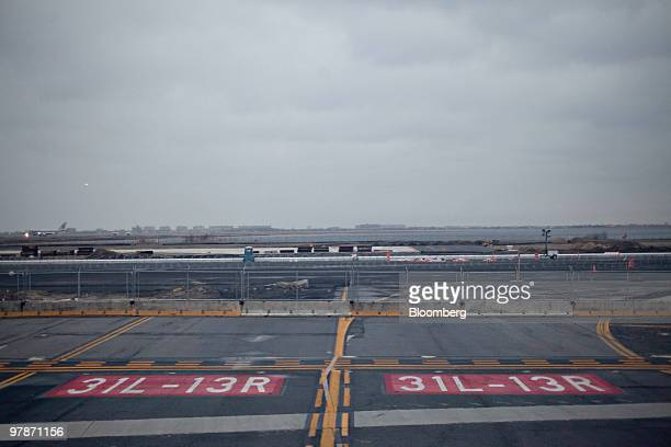 A marking for runway 13R31L appears near a fenced off entrance to the closed runway at John F Kennedy International Airport in New York US on Monday...