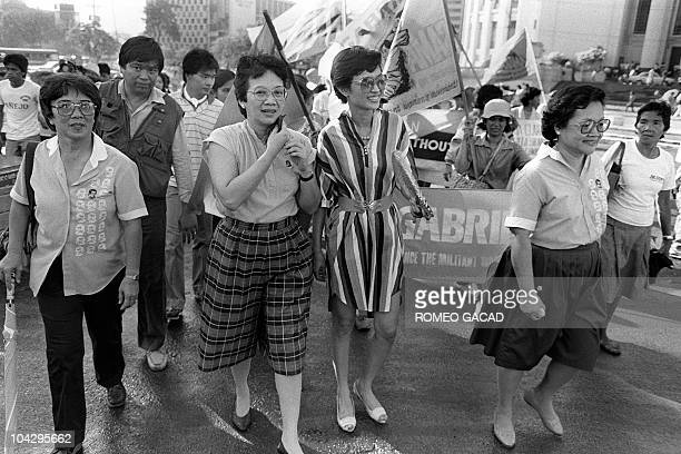 Marking the International women's day Corazon Aquino the wife of the slain opposition leader Benigno S Aquino Jr along with some 2000 Philippino...