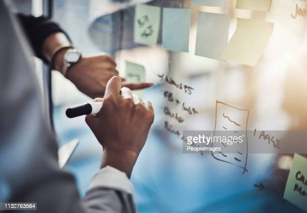 marking their ideas as they go - brainstorming stock pictures, royalty-free photos & images