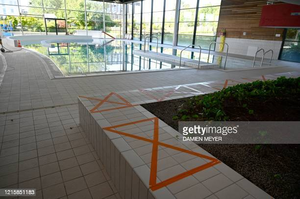 Marking with tape indicates the social distancing rules in La conterie public swimming pool in ChartresdeBretagne suburbs of Rennes western France on...