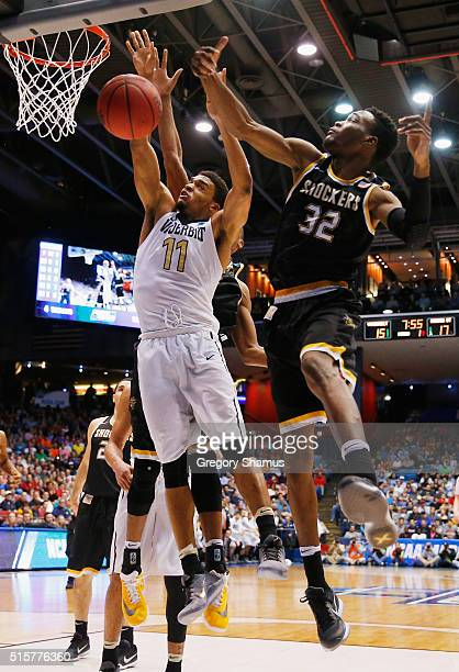 Markis McDuffie of the Wichita State Shockers blocks a shot by Jeff Roberson of the Vanderbilt Commodores in the first half of their game during the...