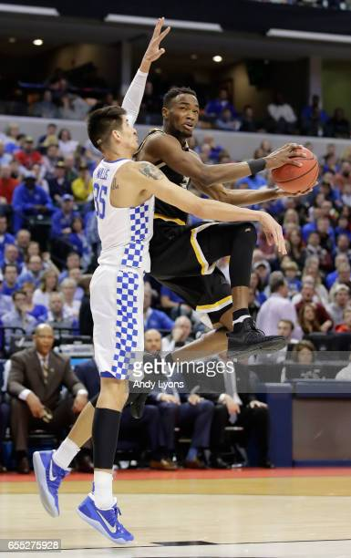 Markis McDuffie of the Wichita State Shockers goes up for a shot against Derek Willis of the Kentucky Wildcats in the first half during the second...