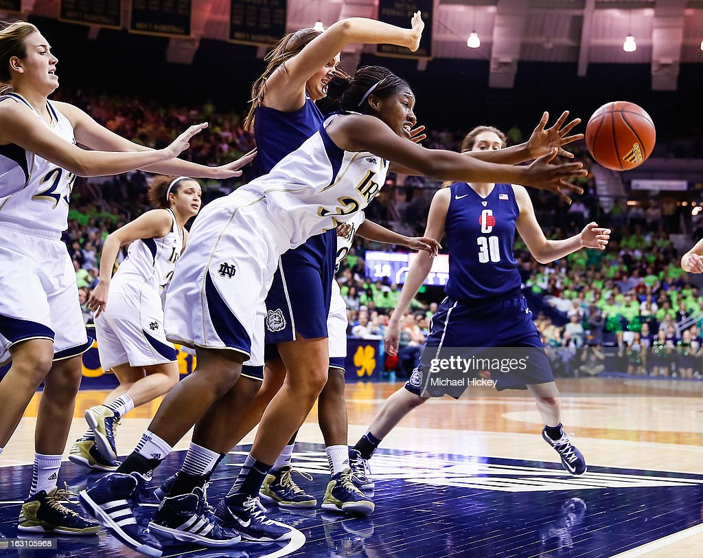 Markisha Wright #34 of the Notre Dame Fighting Irish reaches for a loose ball as Stefanie Dolson #31 of the Connecticut Huskies looks on at Purcel Pavilion on March 4, 2013 in South Bend, Indiana.