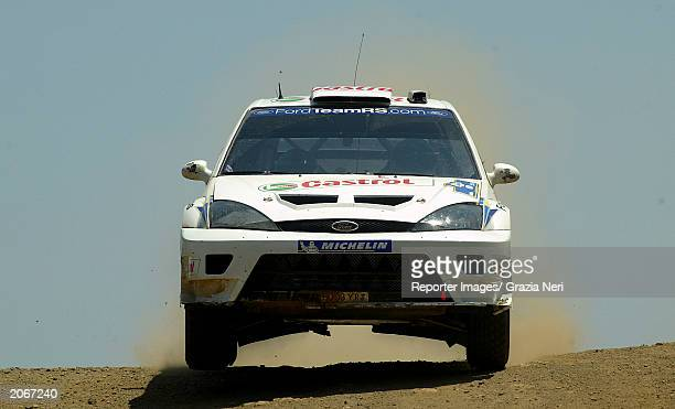 Markko Martin drives his Ford Focus RS WRC during the final stage of the WRC Acropolis Rally on June 8 2003 in Greece