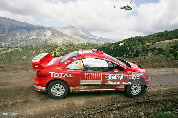 Markko Martin of Estonia and codriver Michael Park of Britain and Peugeot in action during the WRC Rally of Turkey 2005 on June 3 2005 in Antalya...