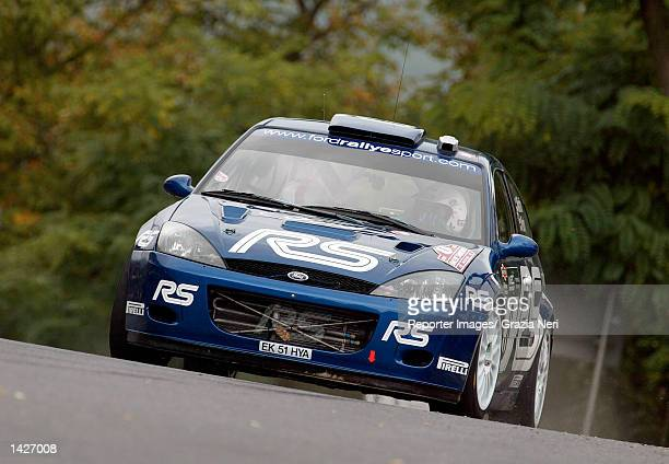 SAN REMO ITALY Markko Martin of Estonia and the Ford Focus RS WRC team in action during the first stage of the San Remo Rally the eleventh stage of...