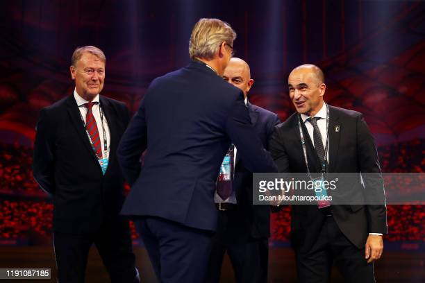 Markku Kanerva Head Coach of Finland shakes hands with Roberto Martinez Head Coach of Belgium as Age Hareide Head Coach of Denmark and Stanislav...