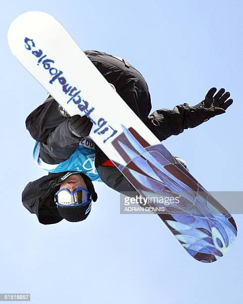 Markku Koski of Finland goes upside down during his qualifying run of the halfpipe snowboarding competition at the XIX Winter Olympic Games at Park...