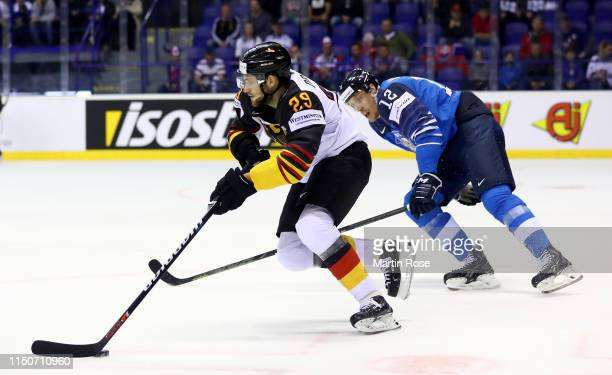 Marko Antilla of Finland challenges Leon Draisaitl of Germany during the 2019 IIHF Ice Hockey World Championship Slovakia group A game between...
